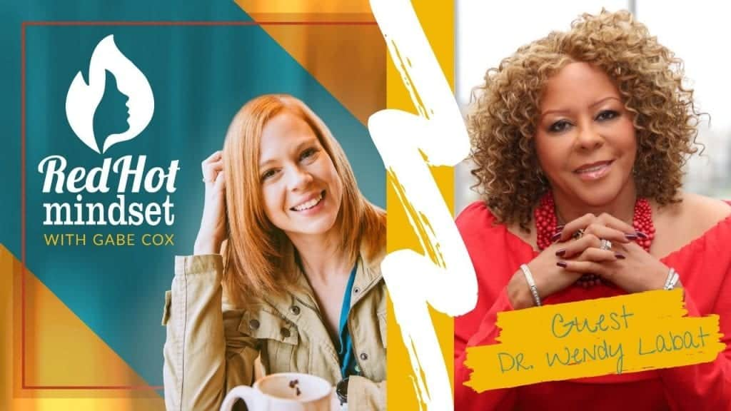 red hot mindset podcast cover photo (white red hot mindset logo with a face in a flame, woman smiling with medium red hair and one hand in her hair and khaki jacket, teal and yellow background), on the right is a woman with short to medium dark brown, curly hair sitting with her hands crossed just under her chin. She's wearing a bright red long-sleeve blouse, a thick, red beaded necklace, and three silver bracelets.