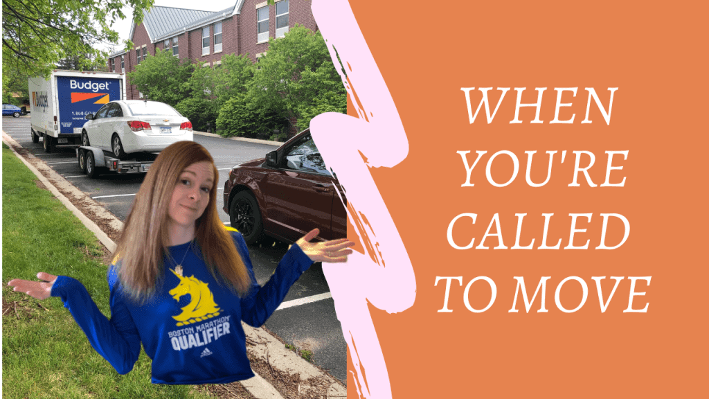 """on the right outside of a hotel there is a budget moving truck towing a white chevy Cruze and a red minivan with a cutout of a woman with long red hair leaning her head to the side with a smirk, arms bent upward with palms facing up, wearing a blue long-sleeve shirt with the Boston Marathon unicorn logo in yellow. Right side is an orange background with the words. """"When you're called to move."""""""