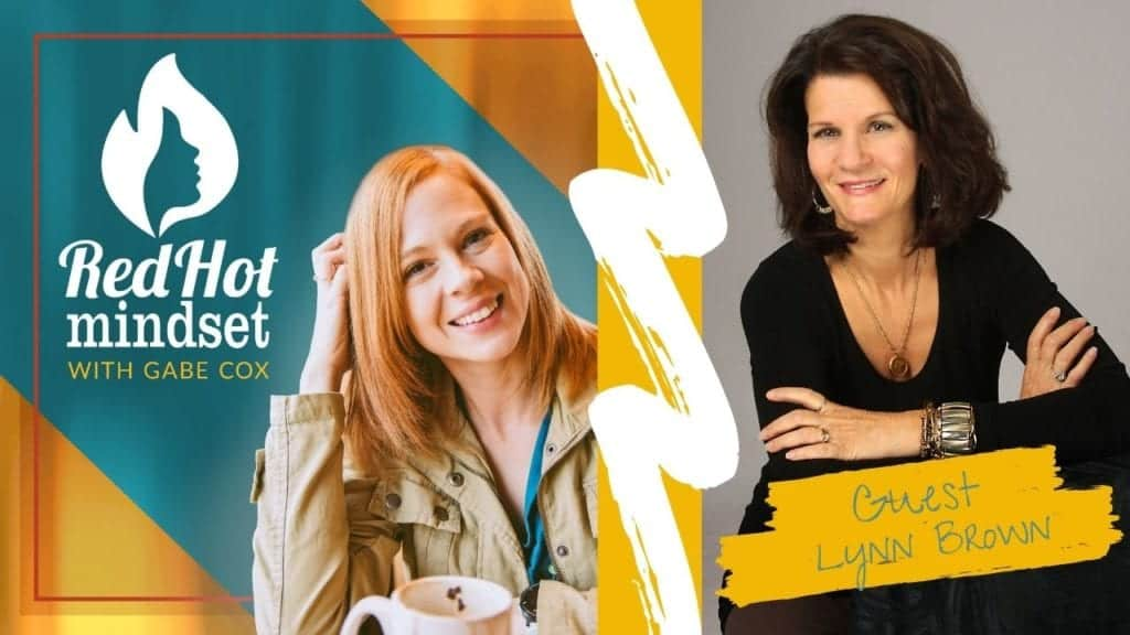 red hot mindset podcast cover photo (white red hot mindset logo with a face in a flame, woman smiling with medium red hair and one hand in her hair and khaki jacket, teal and yellow background), on right side is a woman with medium-length dark brown hair sitting with her arms crossed and smiling. She is wearing a long-sleeve black shirt and leaning on a chair. She is wearing a long gold chain necklace with a pendant and a few gold bracelets of various sizes.