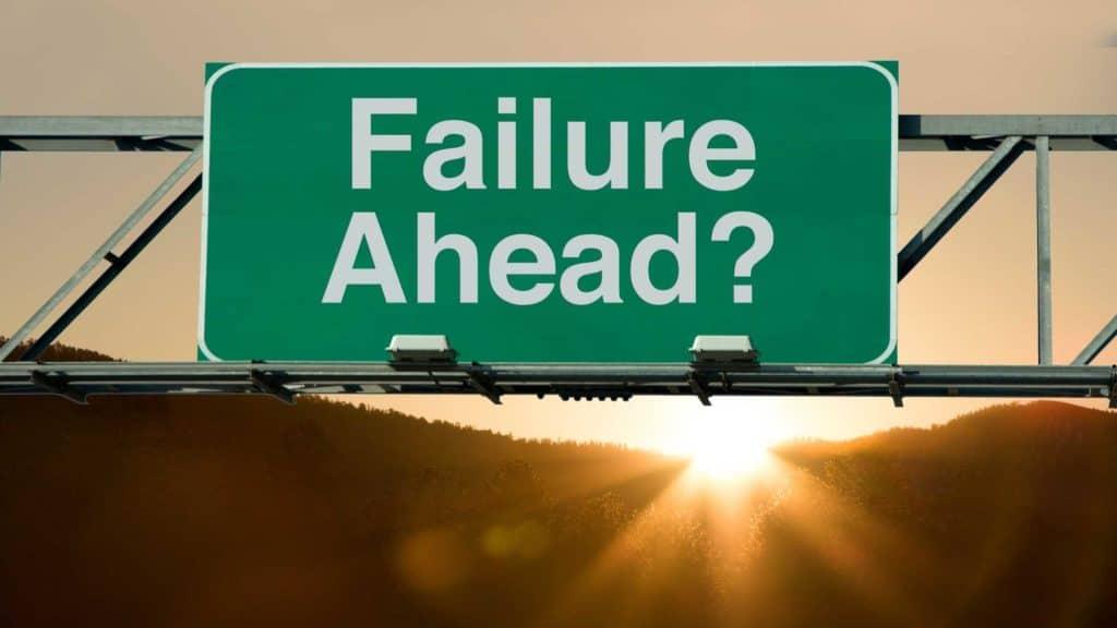 "Green overhead road sign that asks, ""Failure ahead?"""